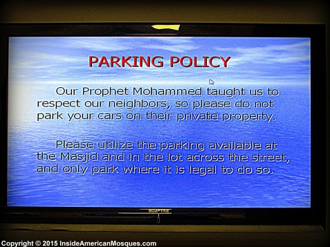 This message on display referring to the mosque's parking policy reads: