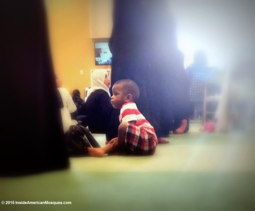 This little one was distracted by watching other playmates at the mosque. Through the course of the Friday prayer, he tried venturing all around the ladies' section of the mosque until he finally sat back down next to his mother. (Masjid As-Sabireen)