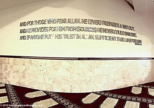 "This verse mounted on the wall of this mosque is from the Quran and reads: ""And for those who fear Allah (God), He (Ever) prepares a way out. And he provides for him from (sources) he never could imagine. And if anyone puts his trust in Allah, sufficient is (Allah) for him."" (Talaq, 2 & 3)"